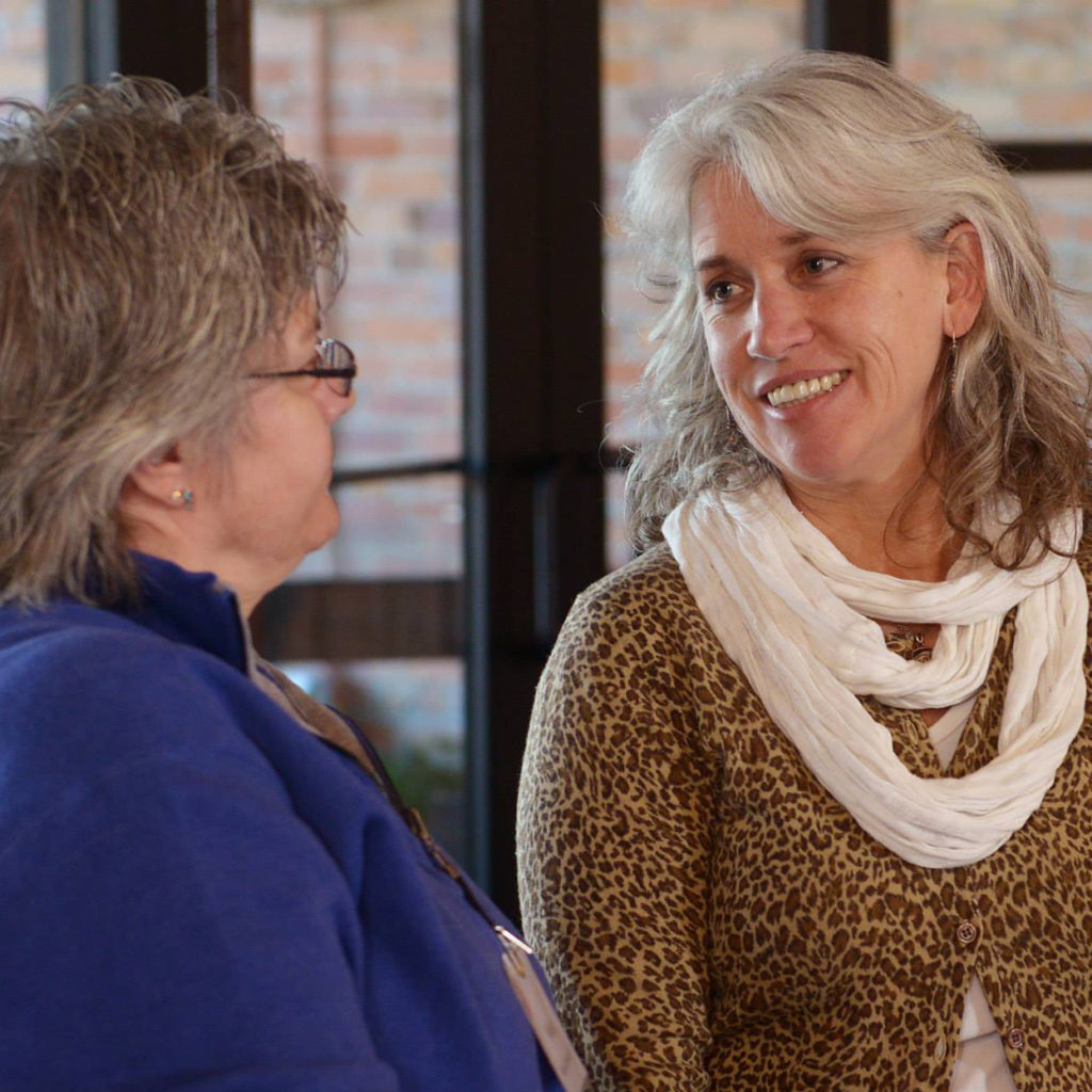 Dr Leslie Peterson Consulting With Patient